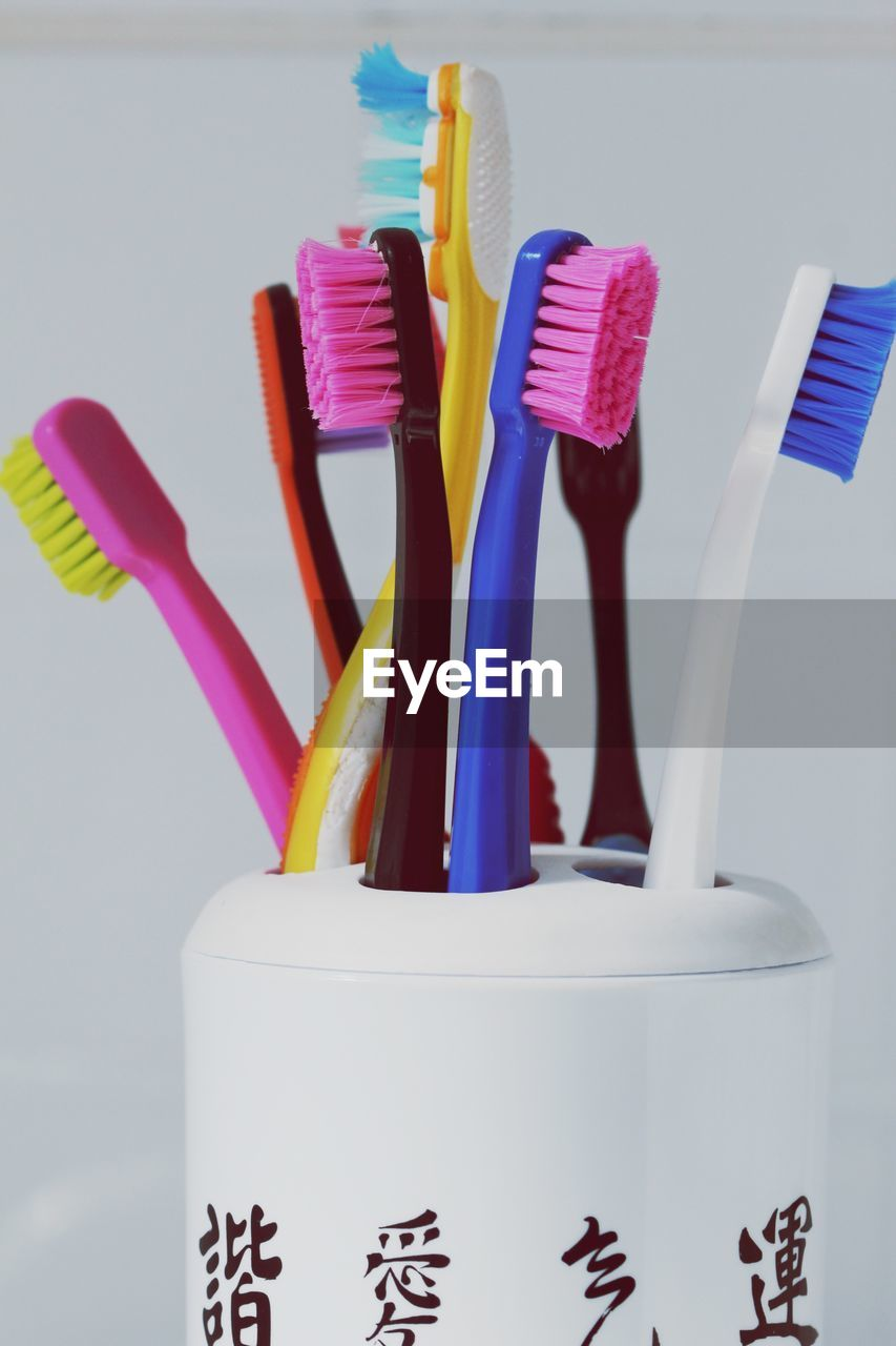 indoors, toothbrush, hygiene, variation, close-up, multi colored, no people, still life, choice, container, group of objects, blue, dental health, collection, studio shot, large group of objects, equipment, desk organizer, plastic