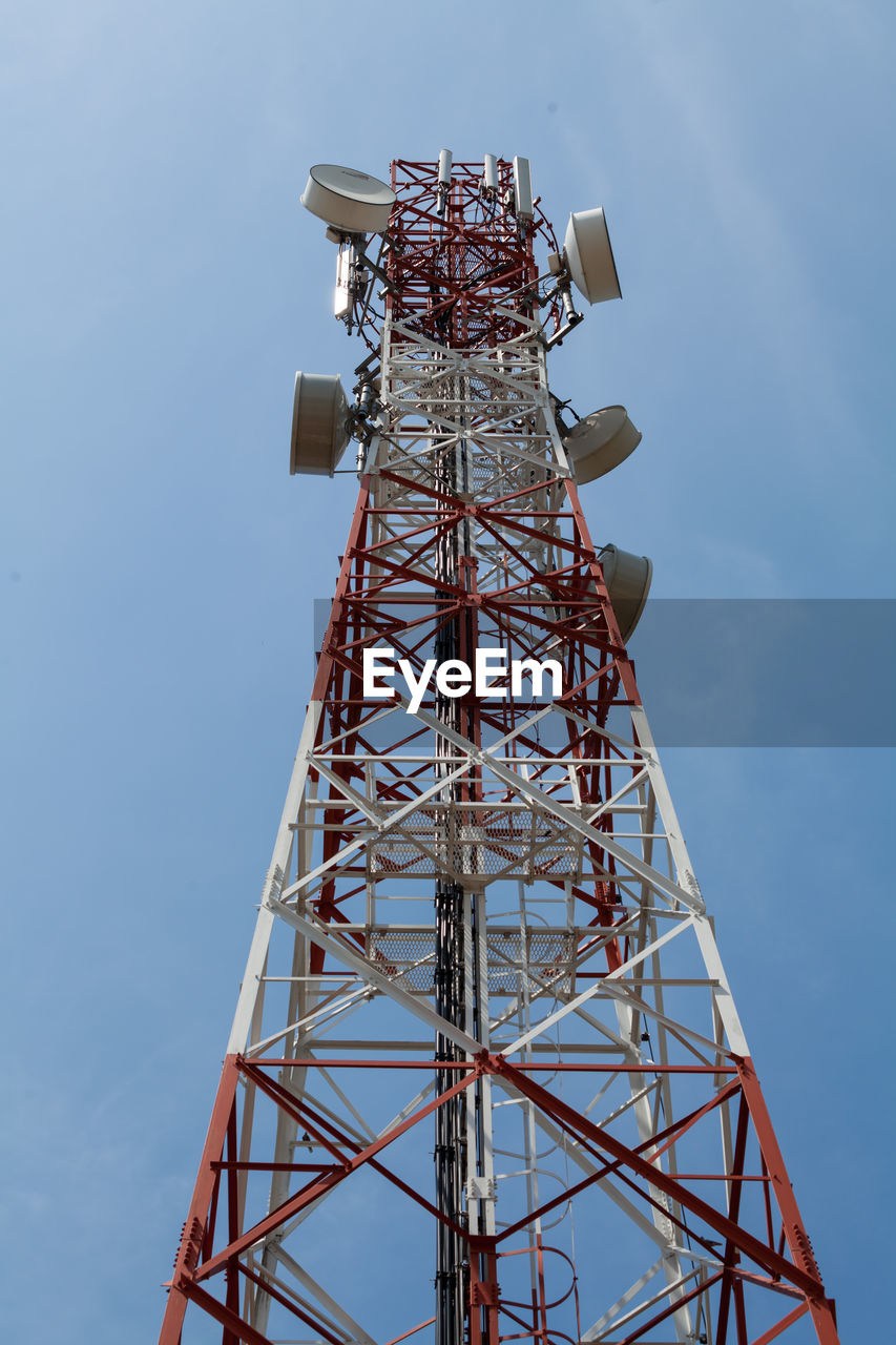 tower, built structure, low angle view, tall - high, architecture, technology, communication, sky, connection, metal, broadcasting, no people, global communications, nature, satellite, telecommunications equipment, day, wireless technology, satellite dish, outdoors