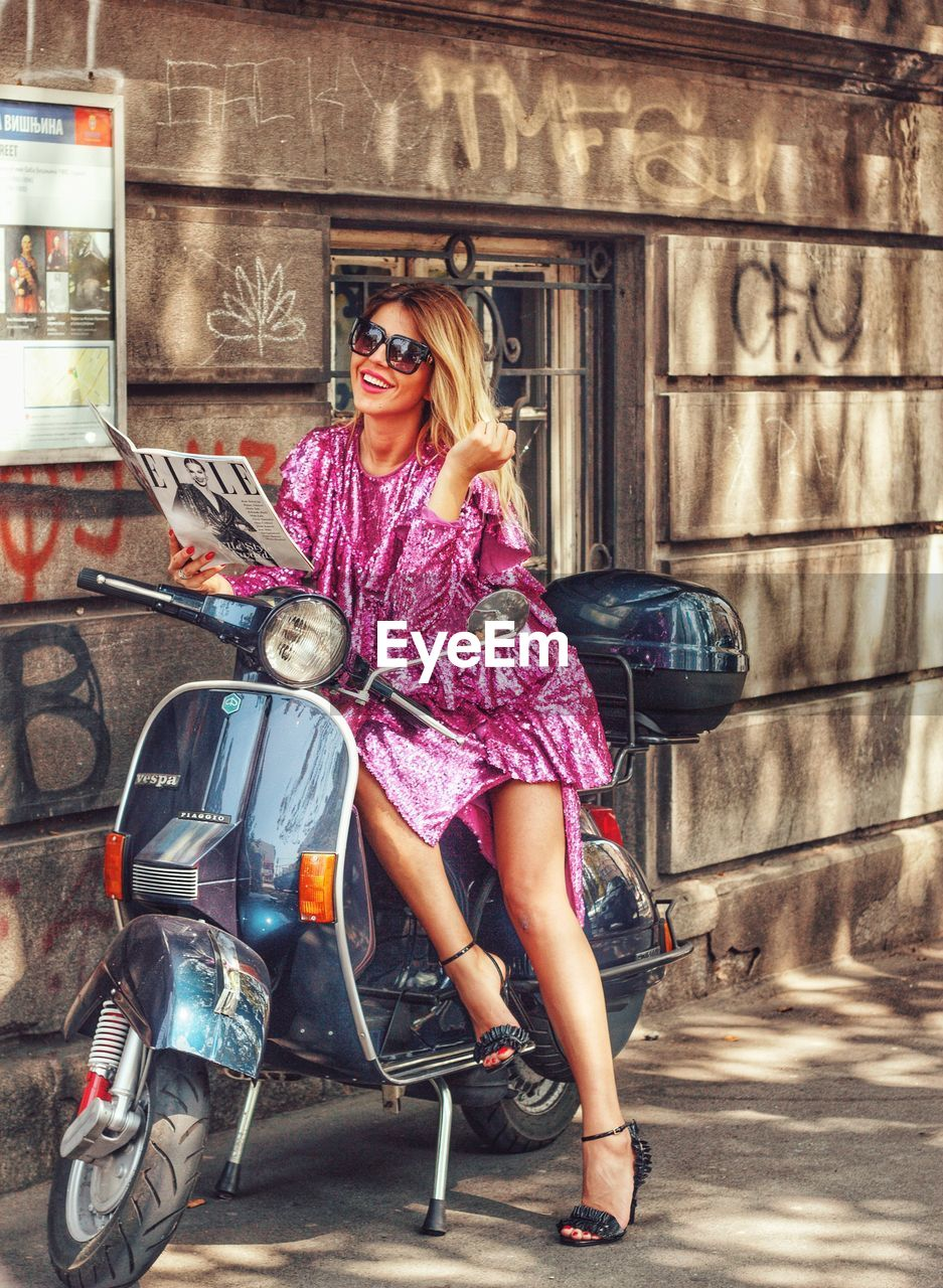 fashion, glasses, women, sunglasses, full length, young women, young adult, one person, adult, beautiful woman, casual clothing, beauty, hair, real people, lifestyles, blond hair, portrait, transportation, hairstyle, outdoors