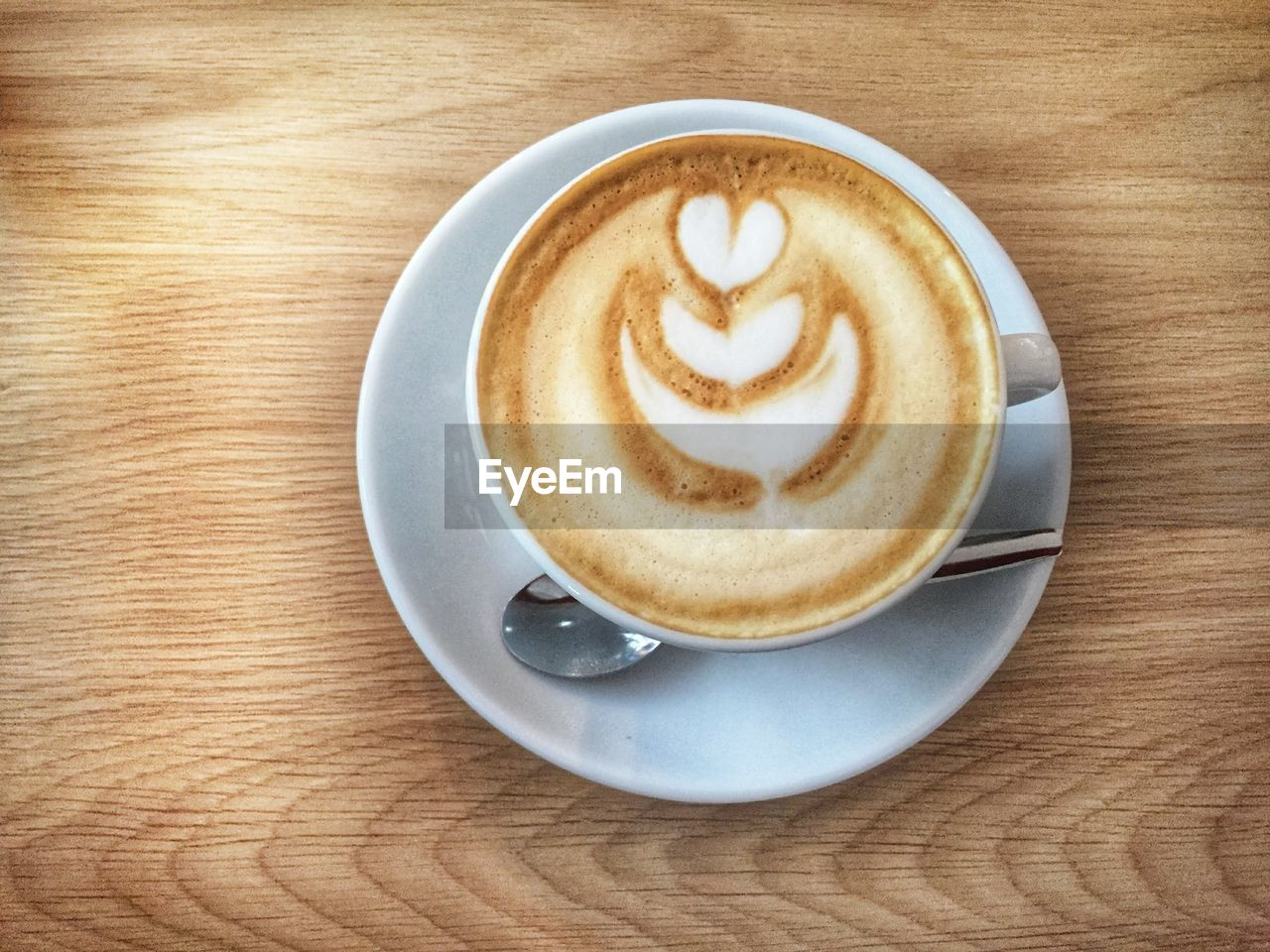 coffee - drink, coffee cup, coffee, food and drink, mug, cup, saucer, drink, table, still life, refreshment, cappuccino, frothy drink, creativity, hot drink, crockery, froth art, freshness, indoors, close-up, no people, latte, breakfast, froth