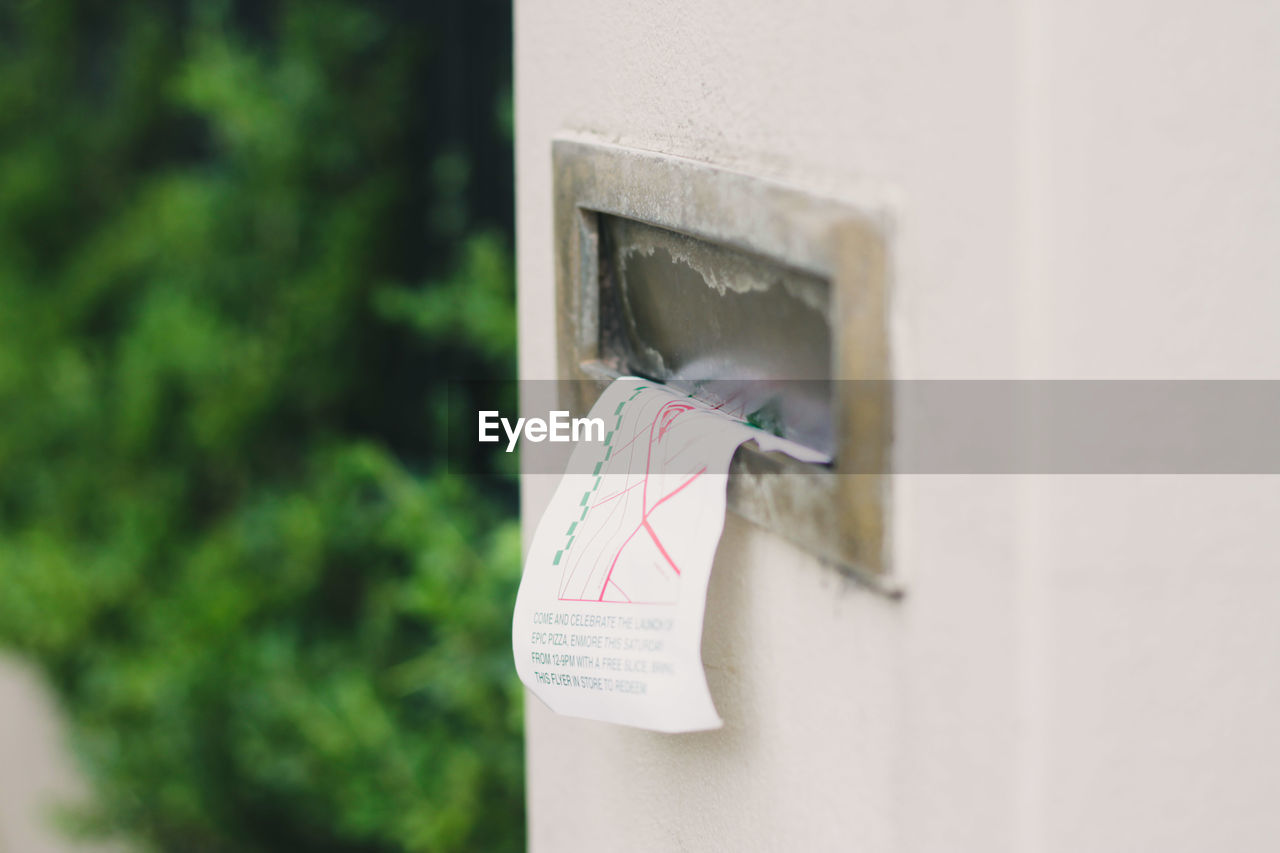 day, no people, communication, paper, close-up, mailbox, selective focus, text, letter, wall - building feature, correspondence, focus on foreground, mail, outdoors, public mailbox, green color, safety, western script, mail slot, architecture, message