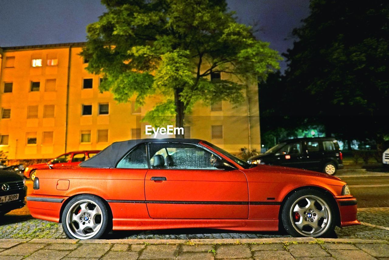 car, transportation, land vehicle, tree, red, no people, architecture, outdoors, building exterior, day