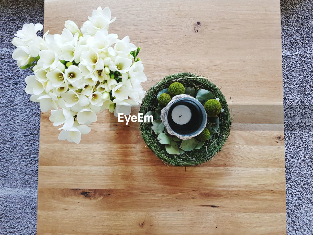 freshness, flower, flowering plant, plant, directly above, table, indoors, high angle view, beauty in nature, wood - material, food and drink, vulnerability, no people, nature, fragility, close-up, vase, still life, green color, food, flower head, flower arrangement