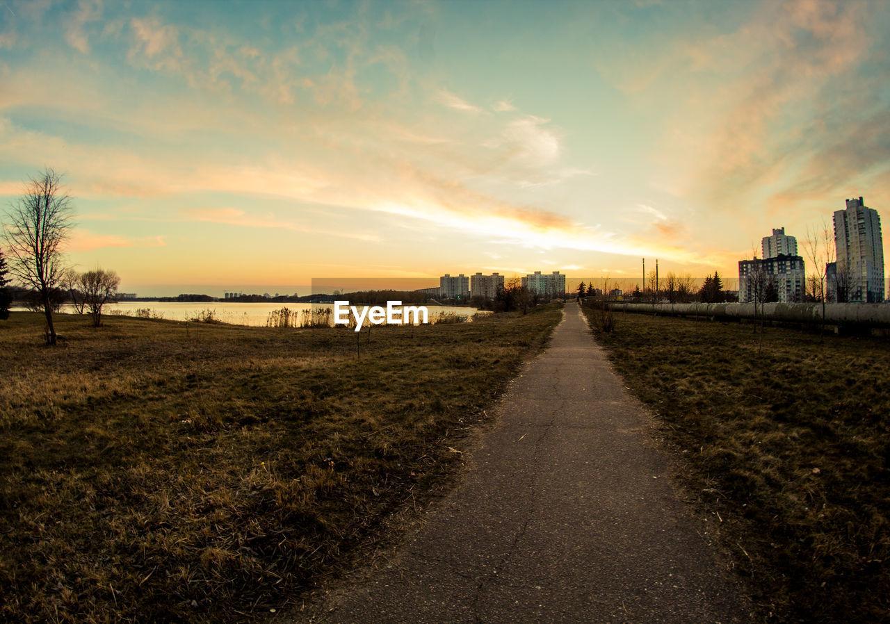 Empty Footpath By Sea Against Sky