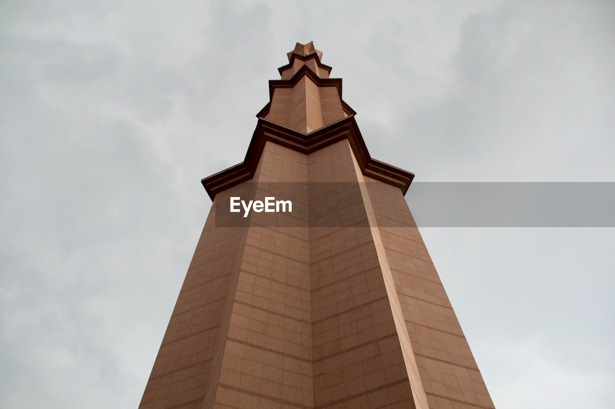 Low angle view of column against sky