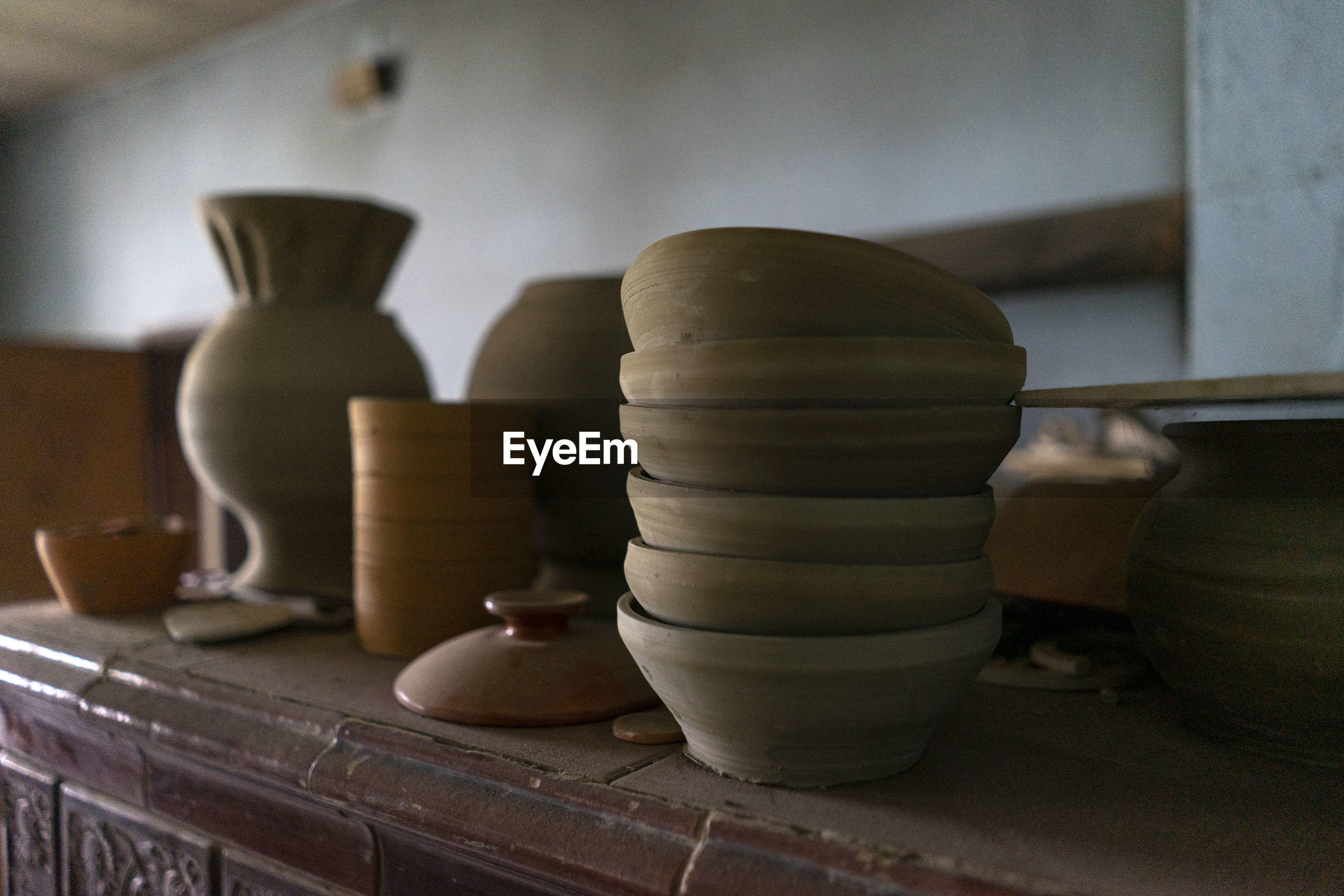 Close-up of ceramic bowls on table