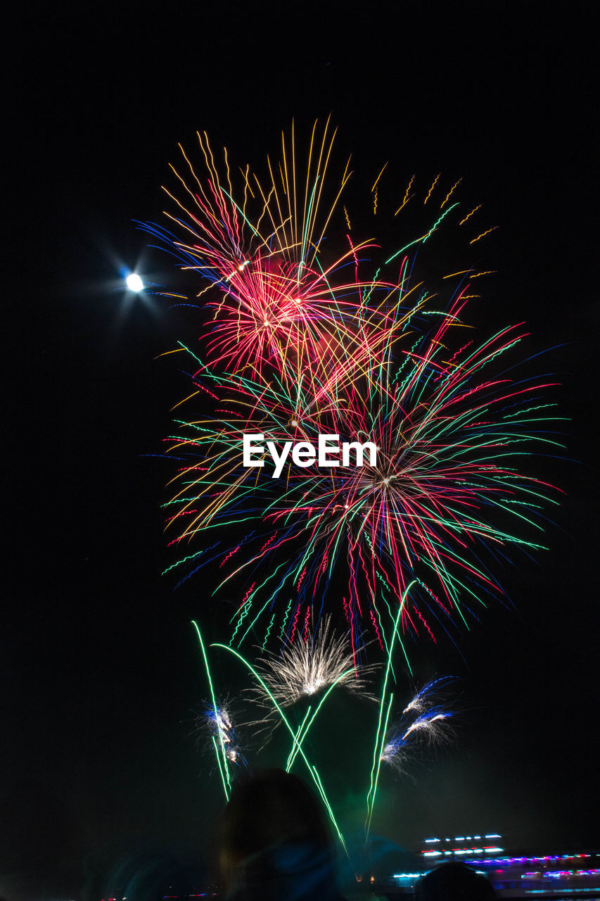 night, illuminated, firework, celebration, motion, arts culture and entertainment, event, exploding, firework display, glowing, multi colored, sky, long exposure, low angle view, firework - man made object, blurred motion, light, sparks, no people, nature