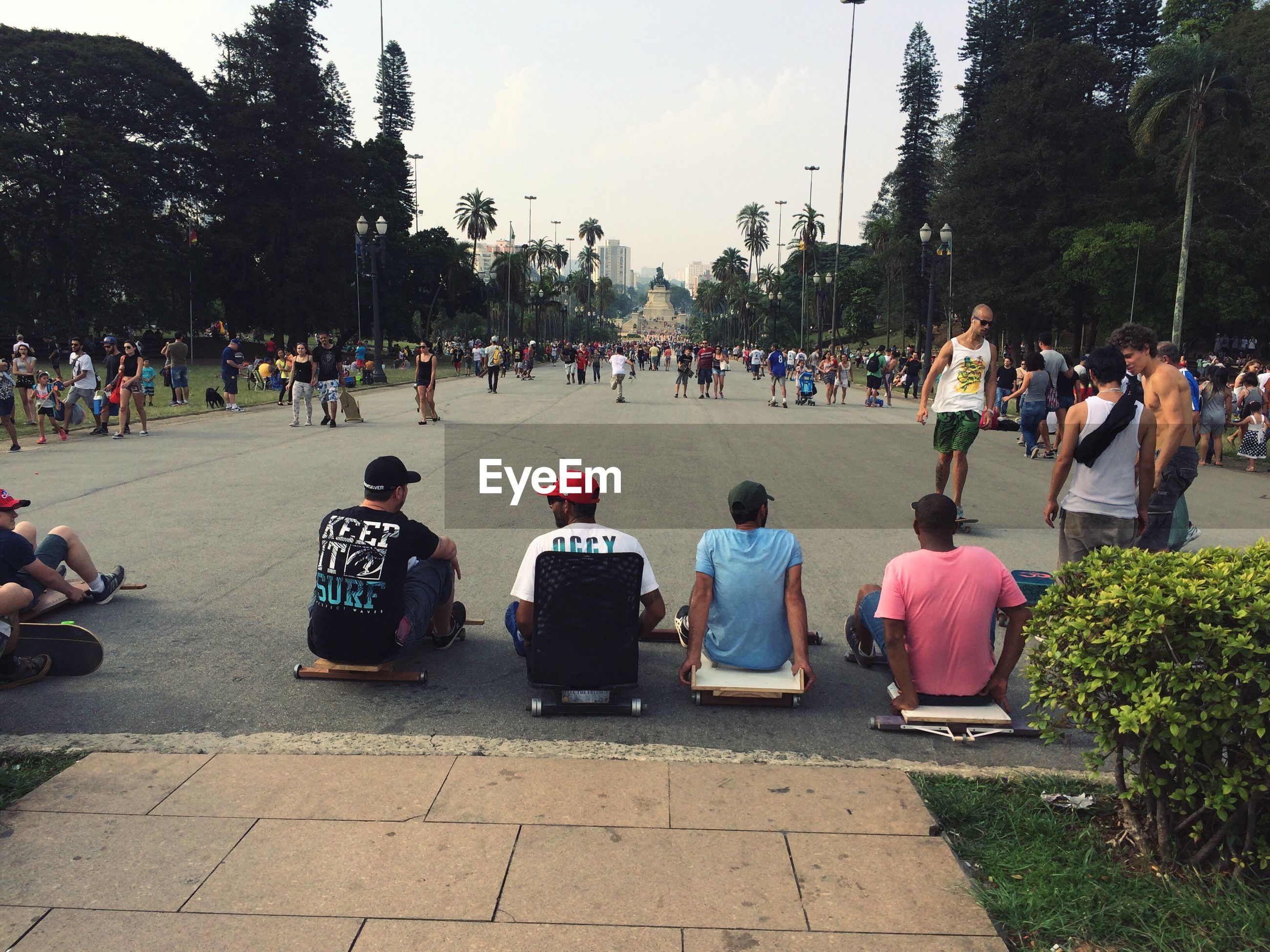 tree, large group of people, sitting, lifestyles, casual clothing, day, sky, outdoors, vacations, park, fragility