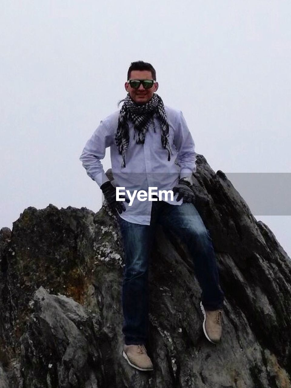 looking at camera, portrait, one person, front view, sunglasses, full length, standing, smiling, young adult, day, confidence, happiness, leisure activity, outdoors, adult, adults only, people, sky, mountain, real people, ski goggles, nature, one man only, only men