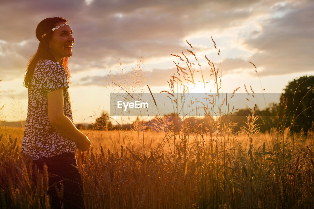 Woman In Wheat At Sunset