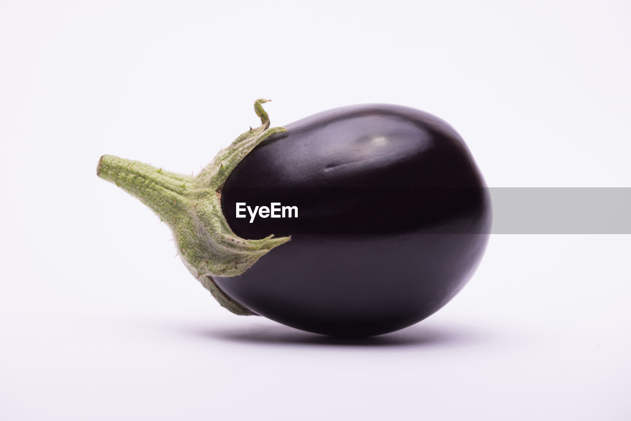 Close-up of eggplant over white background