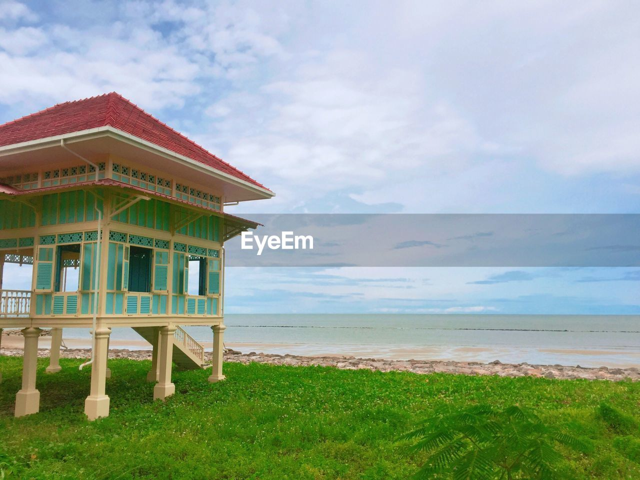 sky, built structure, cloud - sky, architecture, land, sea, beach, nature, grass, water, horizon, tranquil scene, scenics - nature, horizon over water, tranquility, building exterior, beauty in nature, plant, day, no people, outdoors