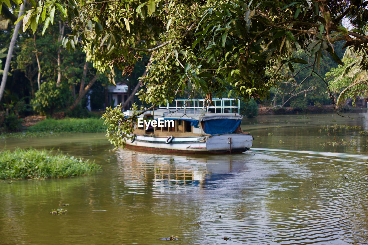 nautical vessel, transportation, water, boat, mode of transport, tree, waterfront, reflection, nature, day, moored, houseboat, outdoors, river, no people, beauty in nature