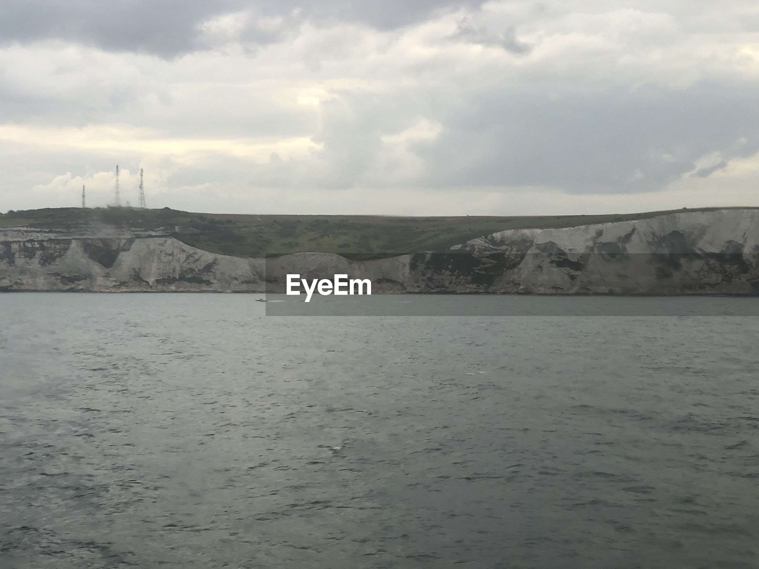 SCENIC VIEW OF SEA AND LAND AGAINST SKY