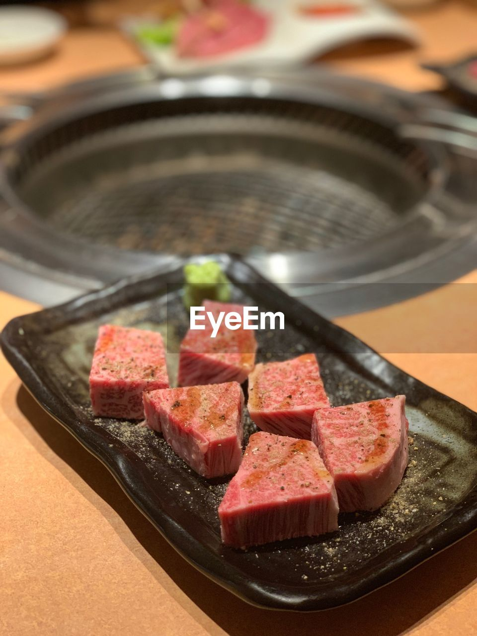 food and drink, food, freshness, meat, red meat, indoors, beef, still life, table, close-up, no people, plate, raw food, preparation, slice, steak, high angle view, ready-to-eat, japanese food, asian food, tray, temptation, dinner