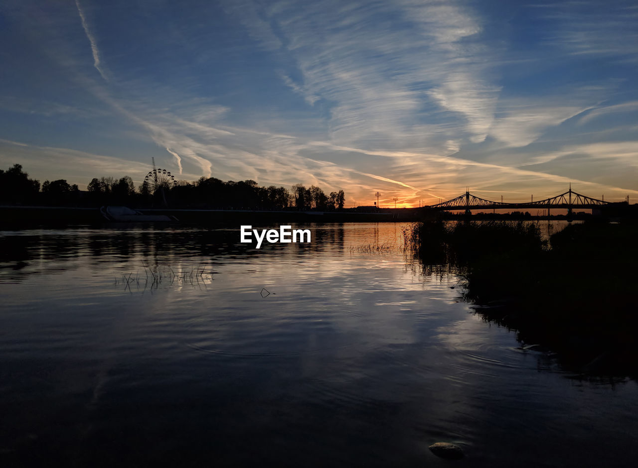 sky, water, reflection, cloud - sky, sunset, silhouette, tranquility, scenics - nature, nature, tranquil scene, no people, beauty in nature, waterfront, bridge, built structure, lake, outdoors, architecture, connection