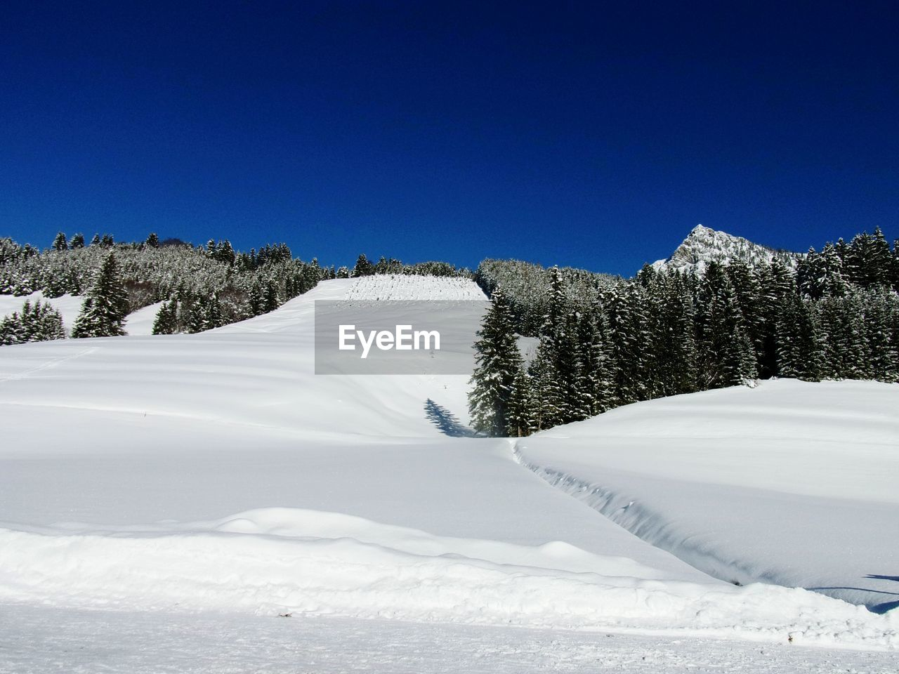 Snowcapped Landscape Against Clear Blue Sky