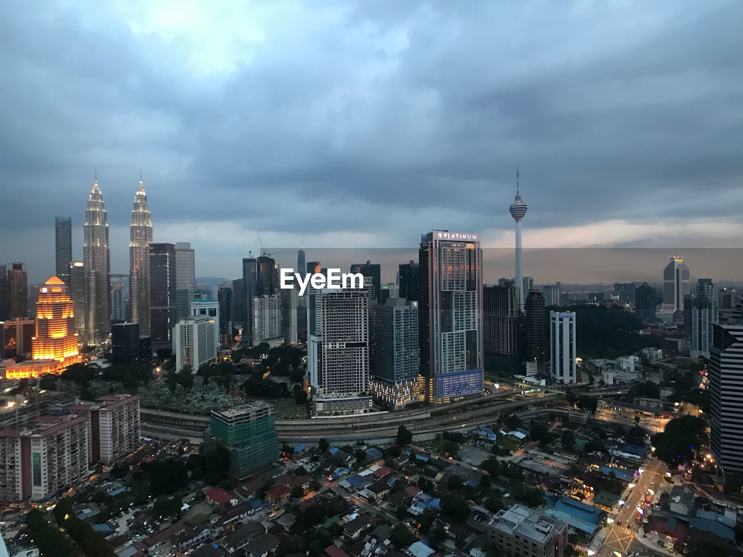 CITY BUILDINGS AGAINST CLOUDY SKY
