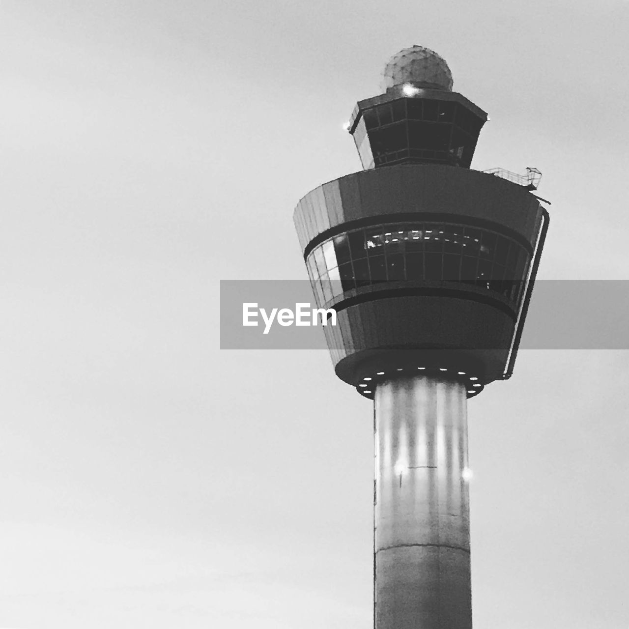 low angle view, sky, architecture, built structure, building exterior, tower, tall - high, nature, clear sky, day, lighting equipment, no people, technology, outdoors, street light, copy space, building, communication, street, skyscraper, spire, global communications