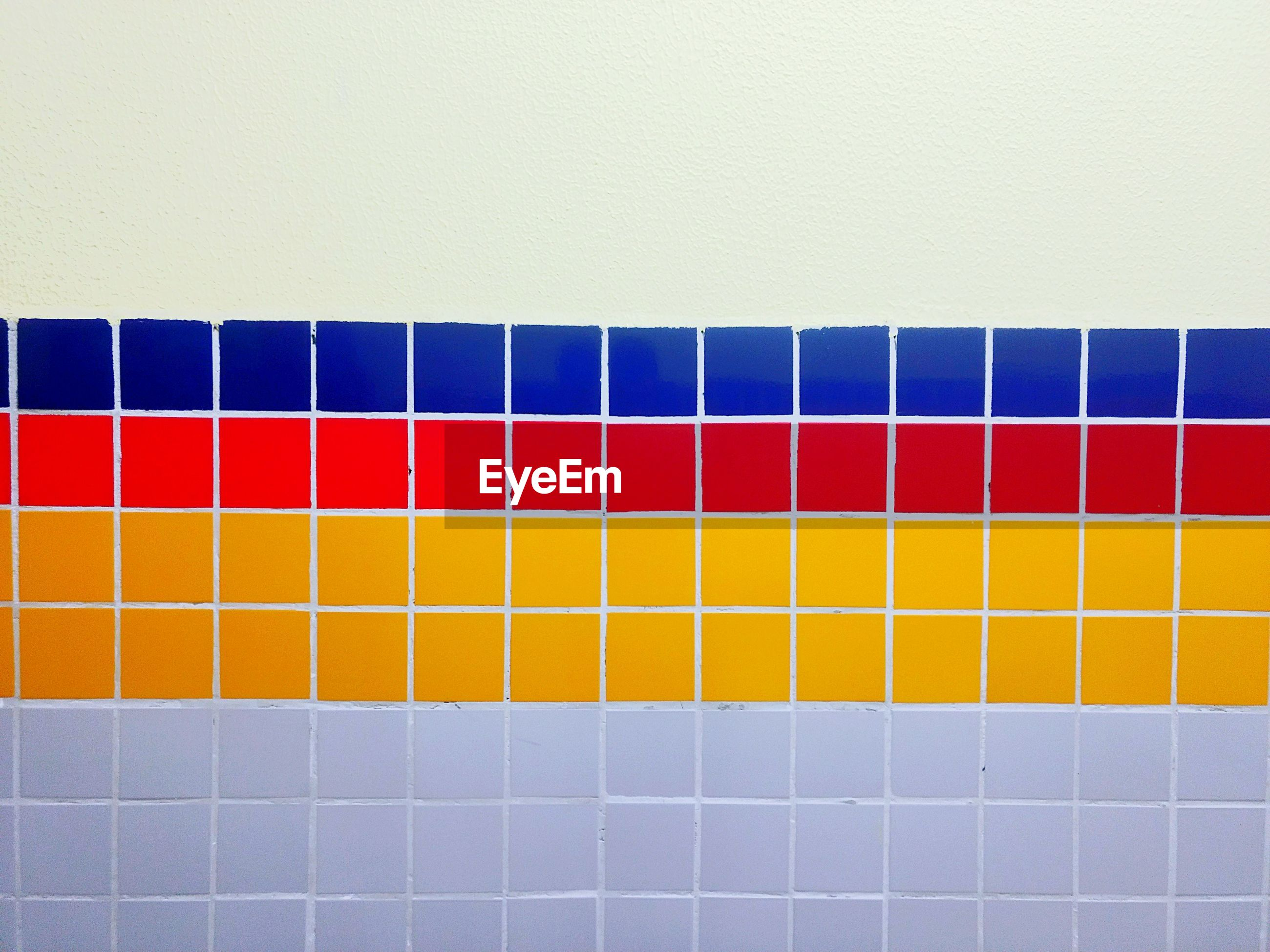 Close-up of multi colored tiles on wall