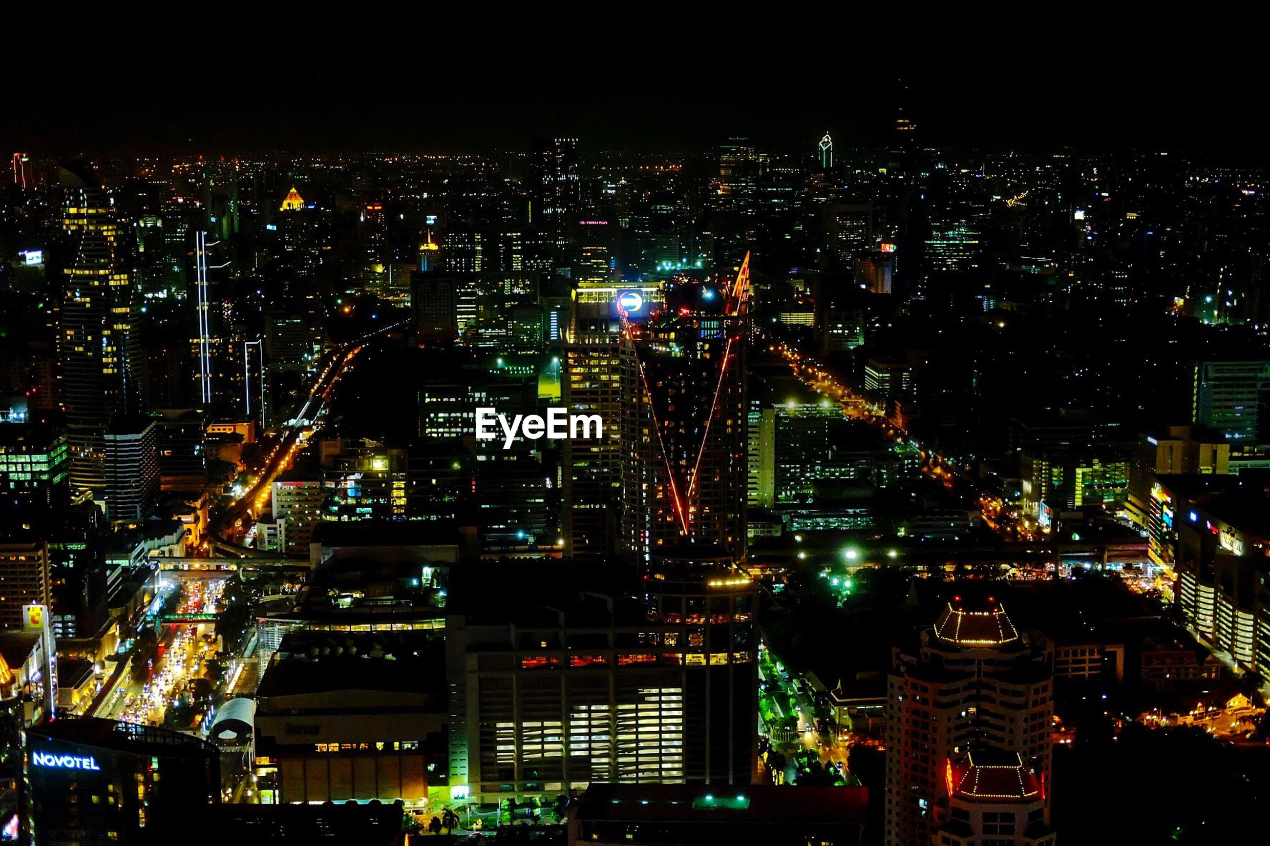 HIGH ANGLE VIEW OF ILLUMINATED CITY BUILDINGS