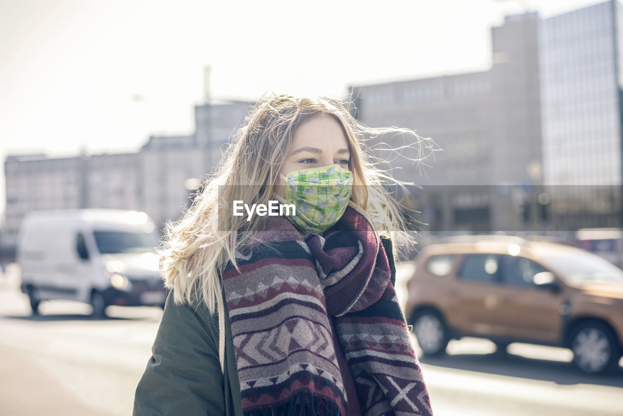 Young woman wearing mask standing on street