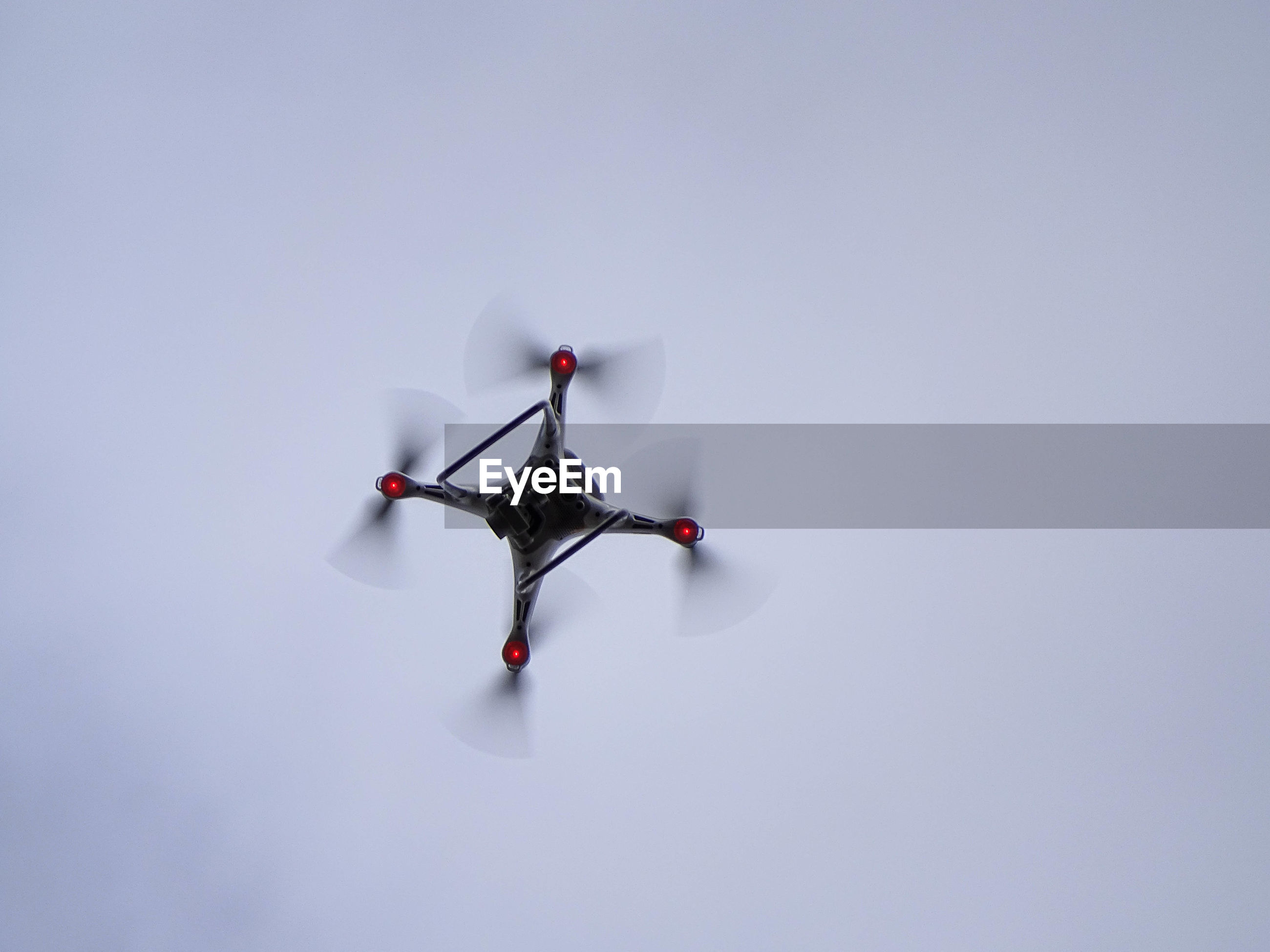 Low angle view of drone against white background
