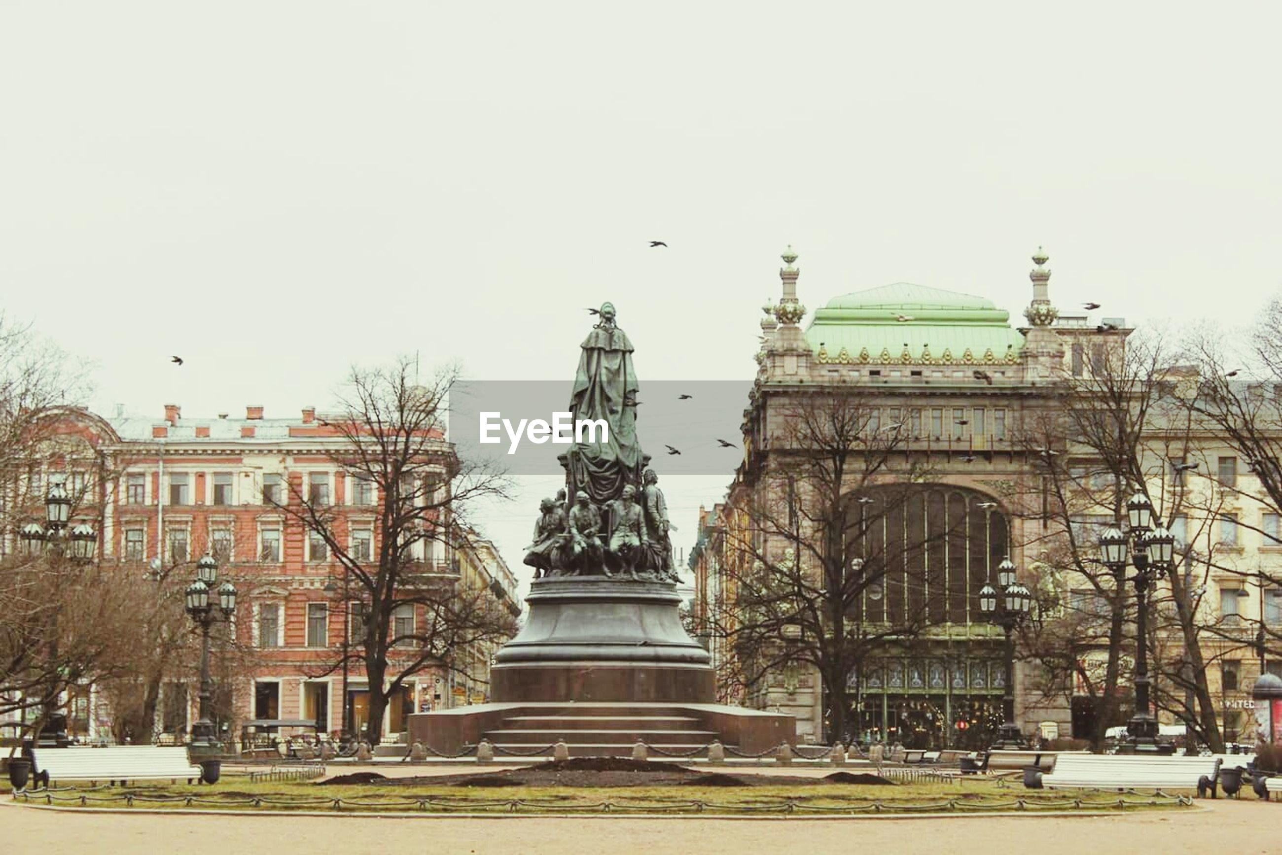 architecture, building exterior, built structure, clear sky, city, statue, bird, sculpture, incidental people, famous place, history, travel destinations, low angle view, travel, capital cities, town square, art and craft, art, human representation, day