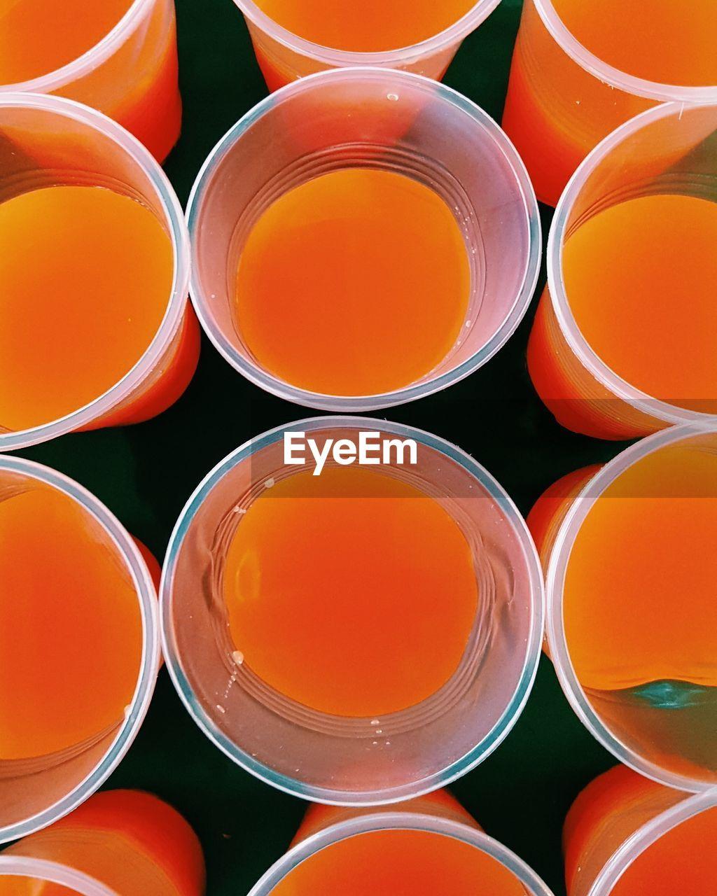 Full frame shot of fresh orange juice in disposable cups