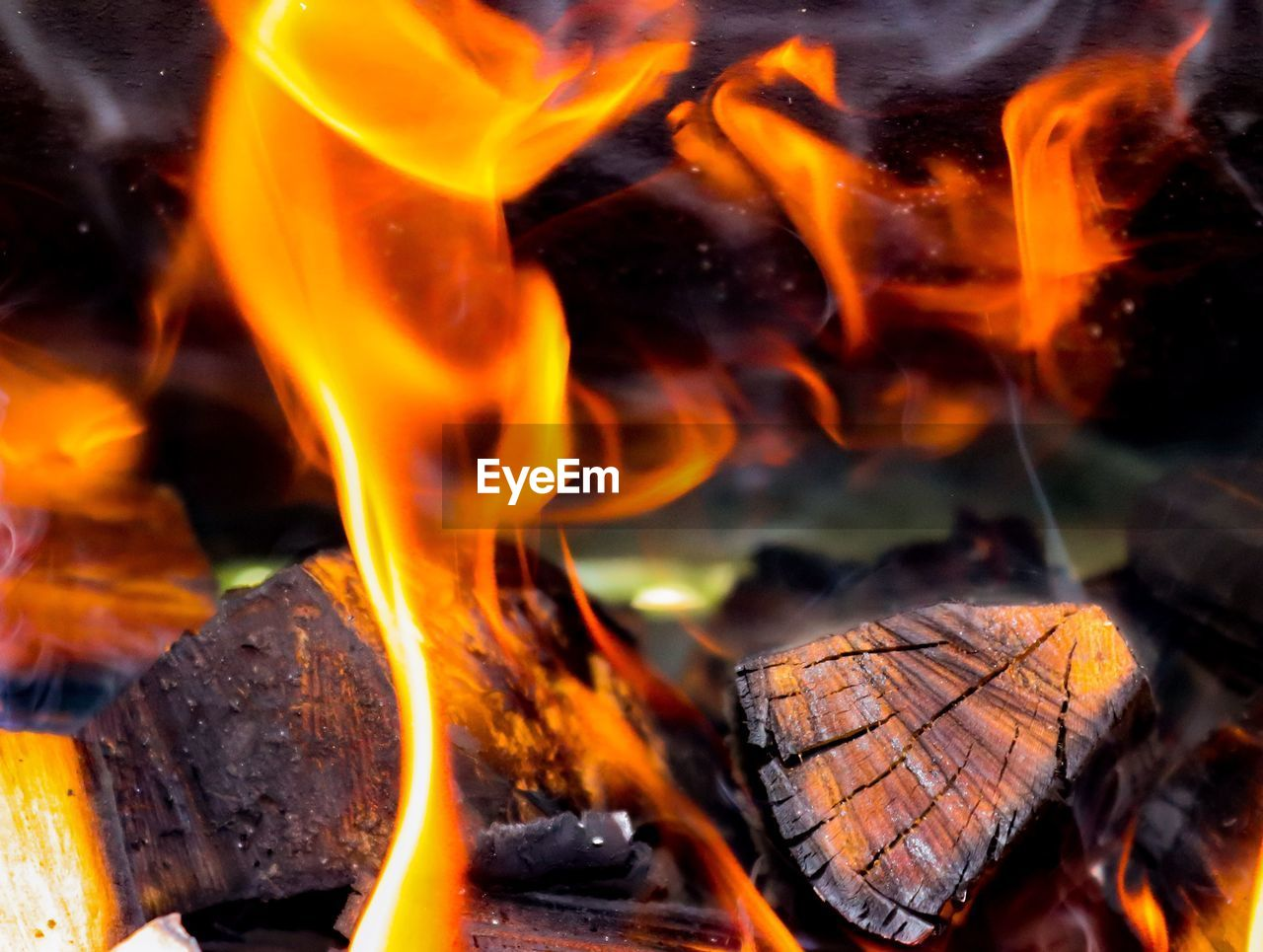 burning, fire, flame, heat - temperature, fire - natural phenomenon, close-up, orange color, no people, wood, nature, log, wood - material, firewood, glowing, outdoors, motion, long exposure, bonfire, timber, selective focus, campfire