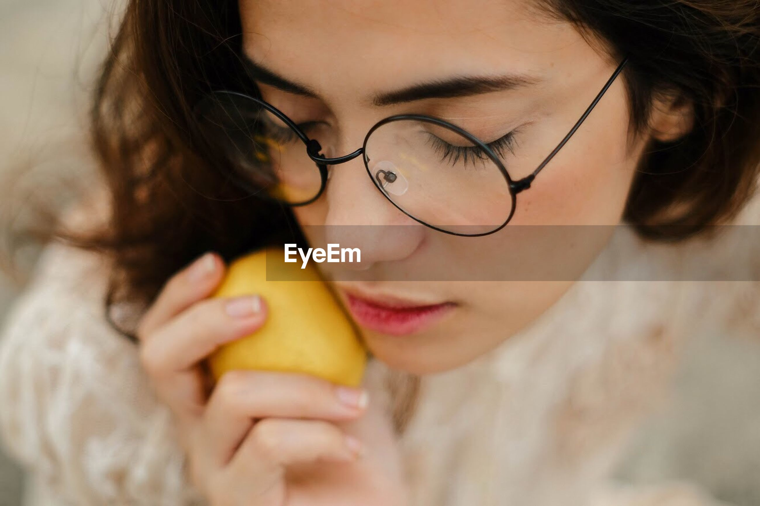 fruit, eyeglasses, one person, food and drink, real people, healthy eating, food, holding, looking down, young adult, close-up, indoors, lifestyles, headshot, childhood, freshness, young women, day, eating, human hand, people, adult