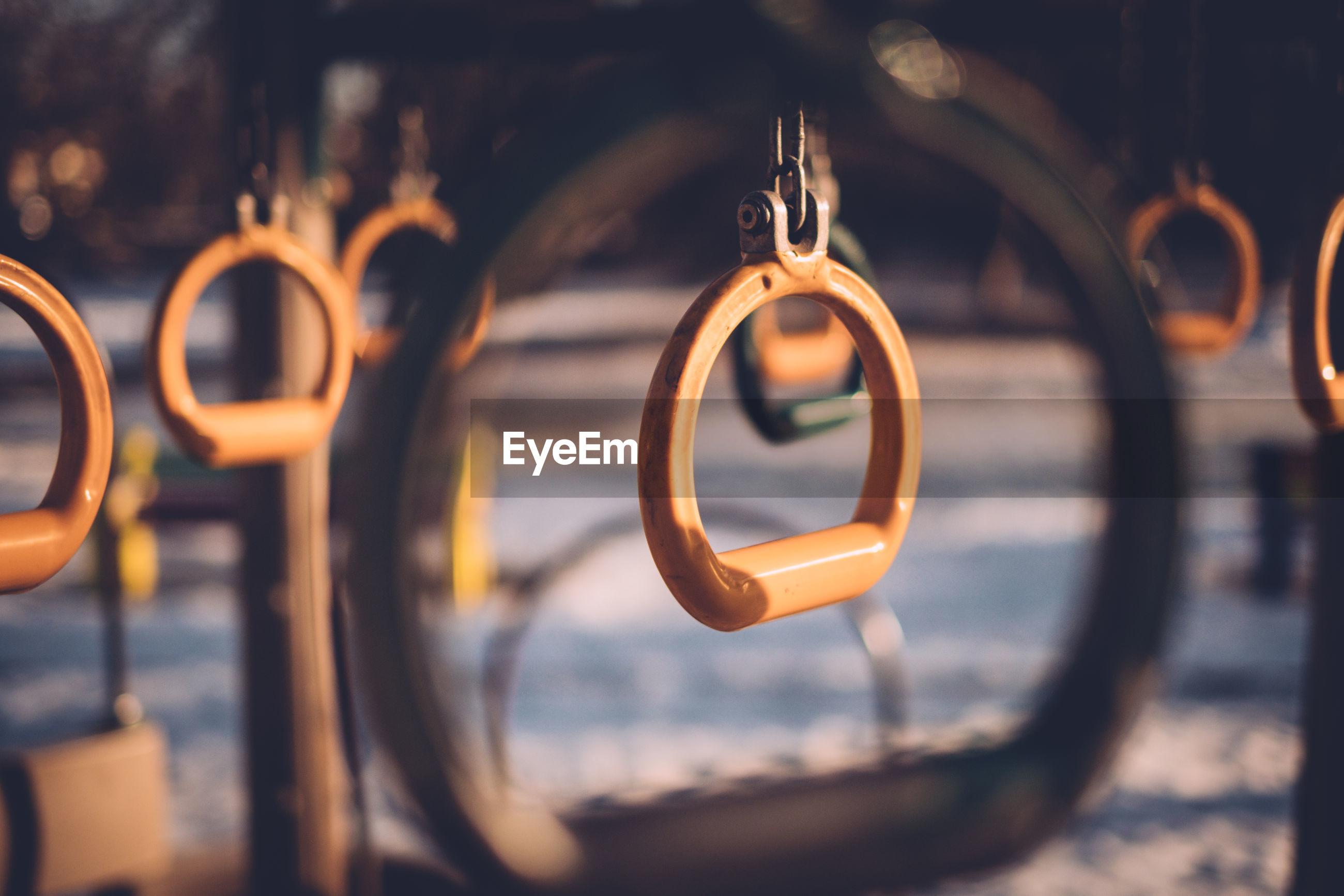 Metallic rings hanging in playground during winter