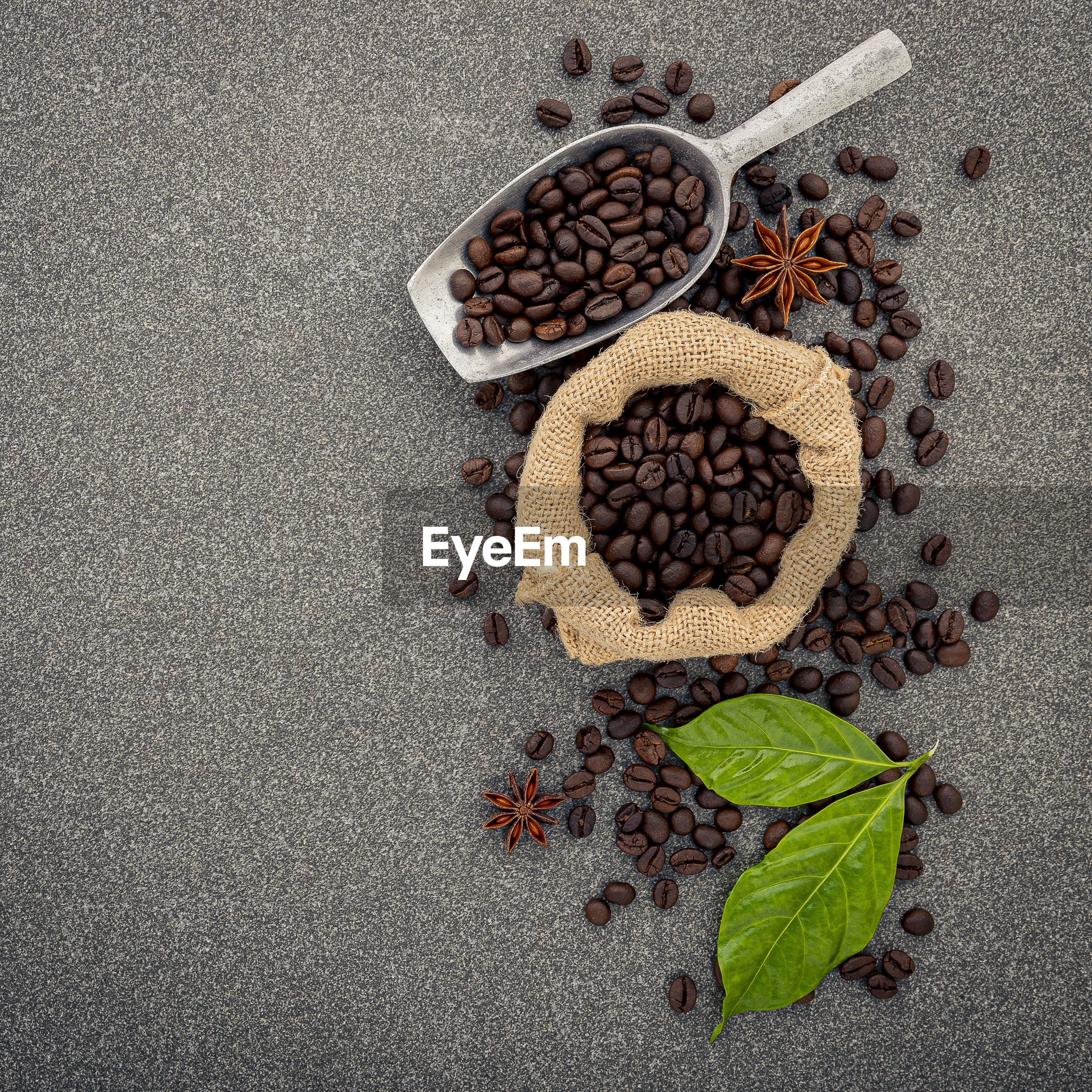 HIGH ANGLE VIEW OF ROASTED COFFEE BEANS IN GLASS