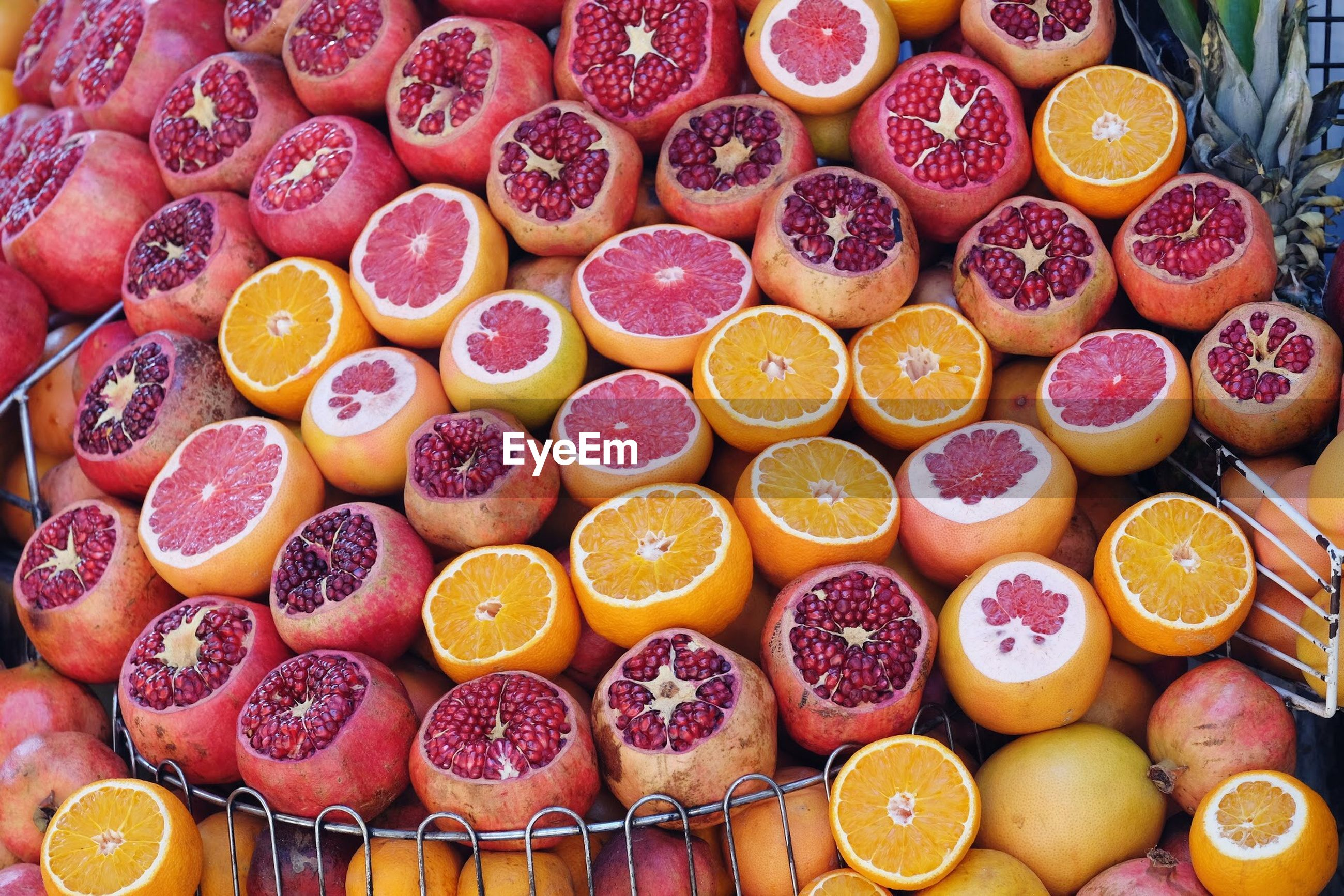 High angle view of grapefruits and pomegranates for sale in market