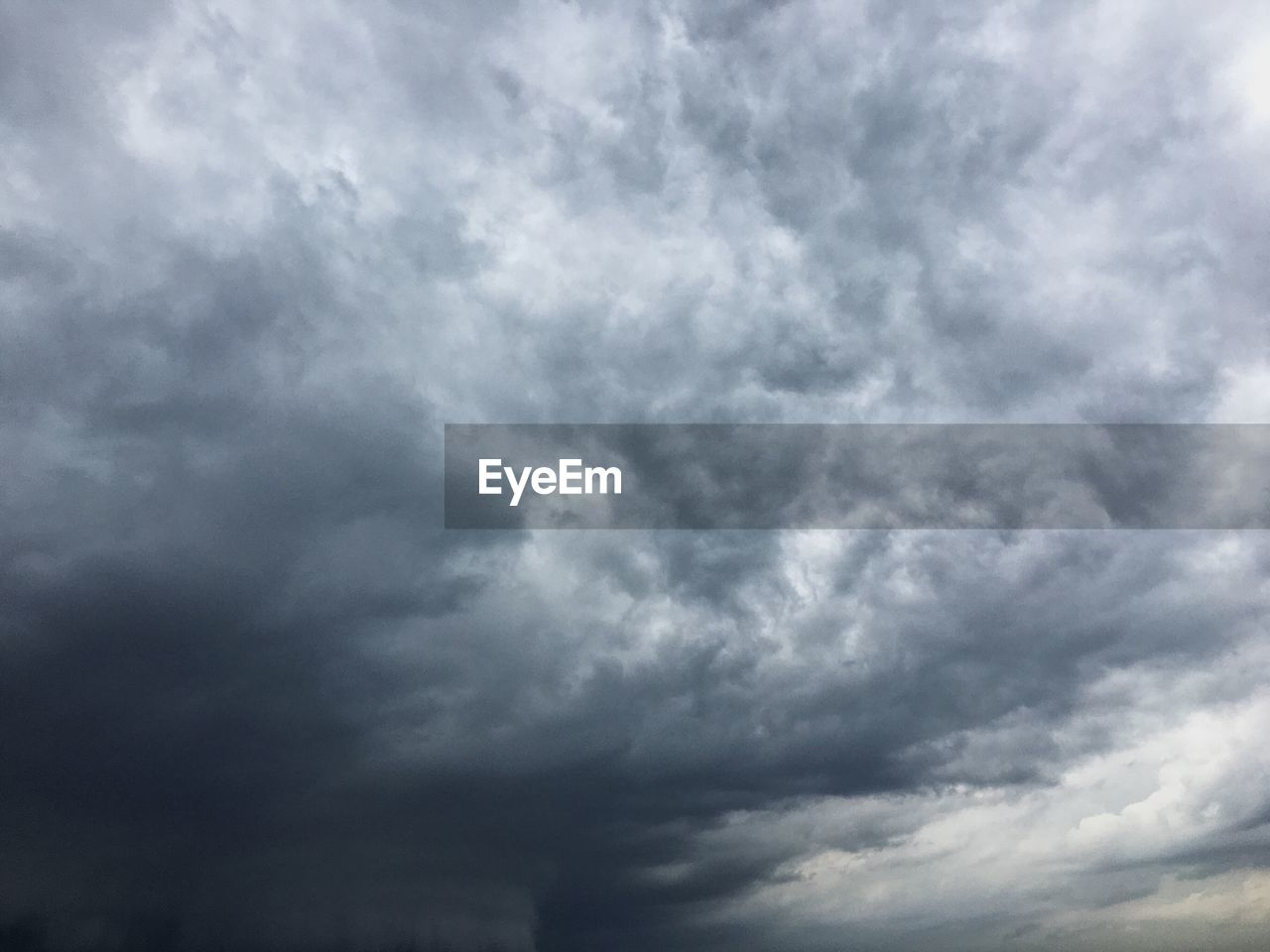 cloud - sky, sky, beauty in nature, storm, low angle view, overcast, scenics - nature, no people, storm cloud, nature, dramatic sky, cloudscape, tranquility, outdoors, day, tranquil scene, thunderstorm, environment, backgrounds, ominous, power in nature, meteorology