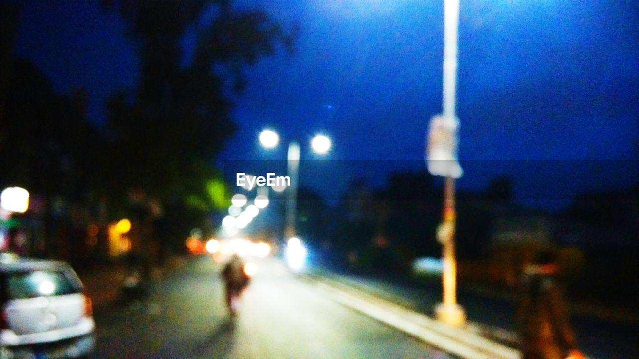 transportation, night, illuminated, mode of transport, car, street, road, land vehicle, no people, outdoors, blue, sky, defocused, city