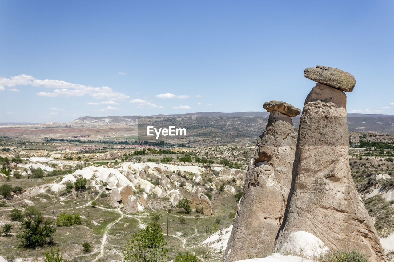sky, rock, nature, mountain, solid, environment, day, landscape, beauty in nature, scenics - nature, rock - object, tranquil scene, no people, tranquility, land, non-urban scene, outdoors, focus on foreground, cloud - sky, rock formation