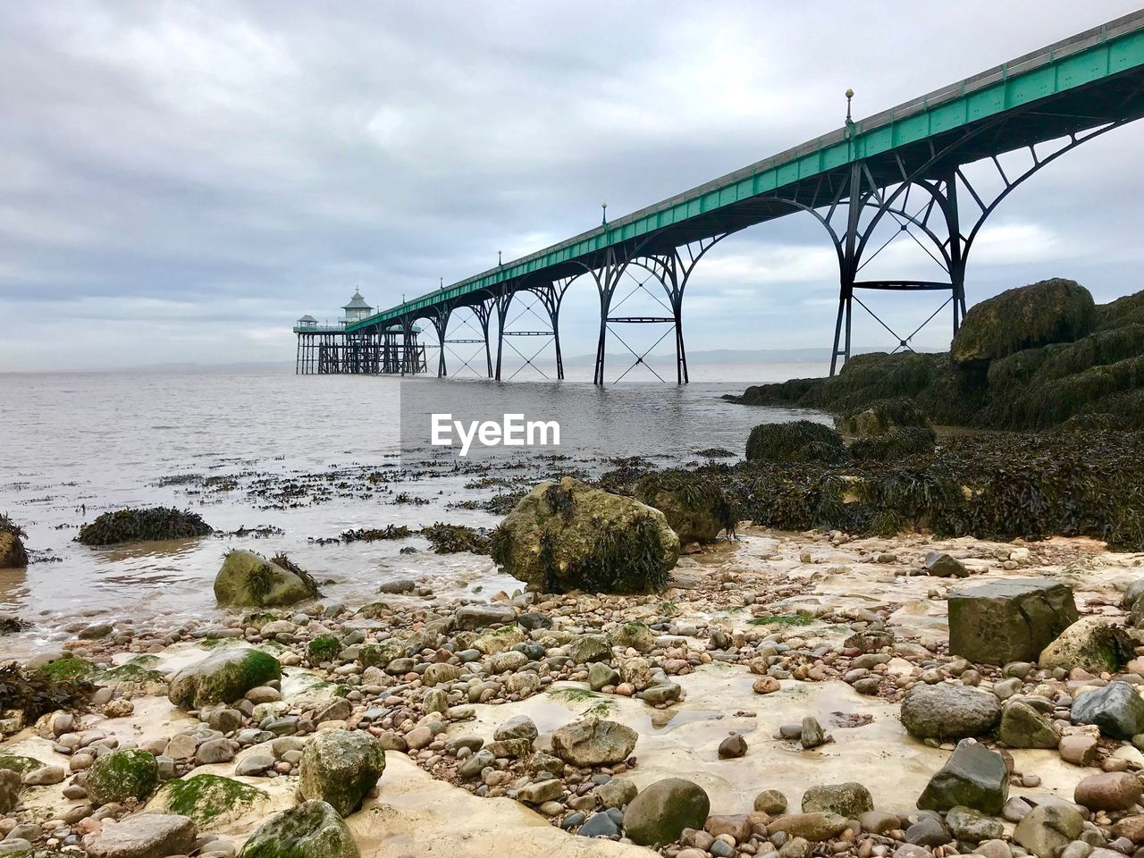 Bridge Over Sea Shore Against Sky