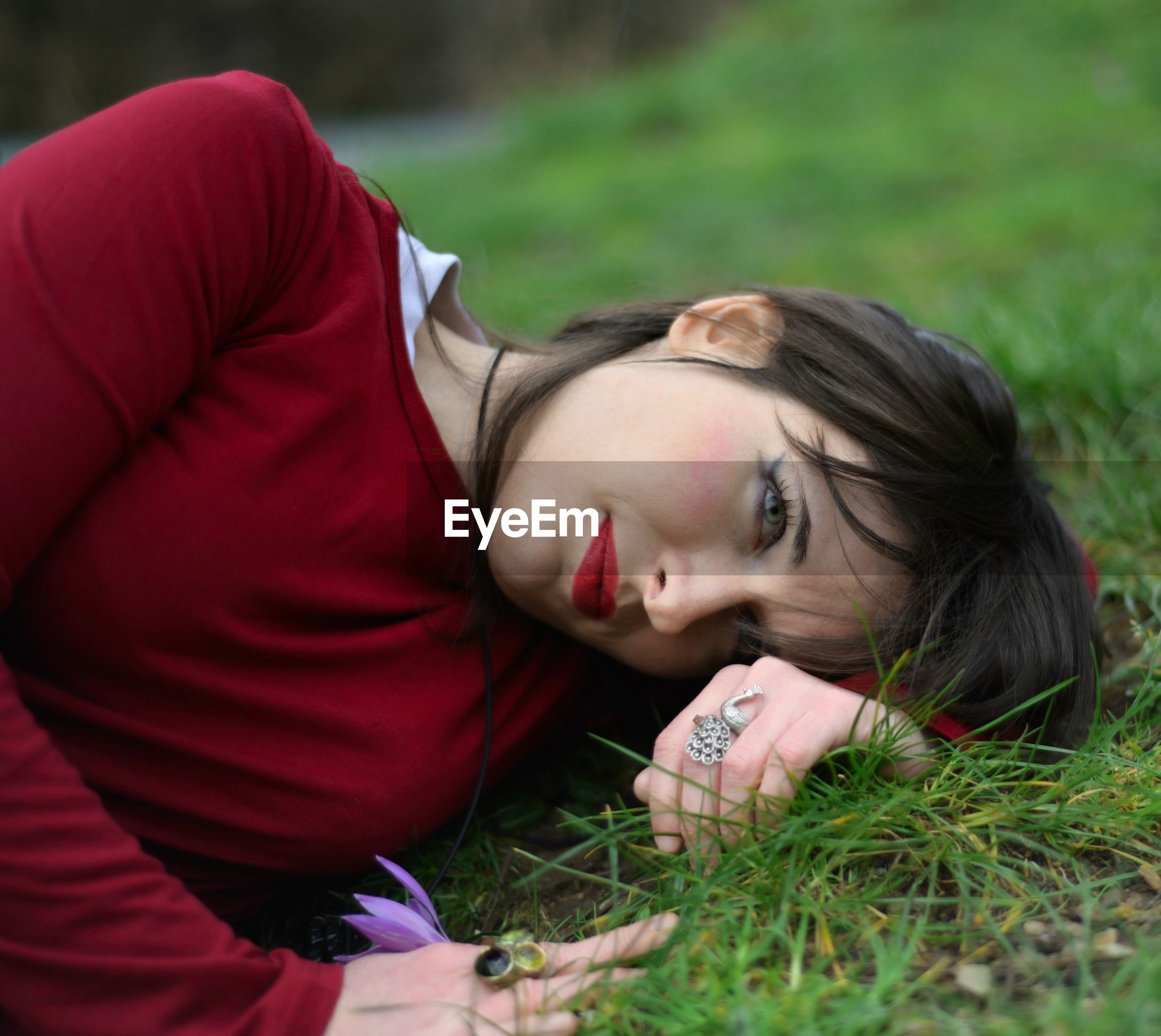 Young woman lying on field