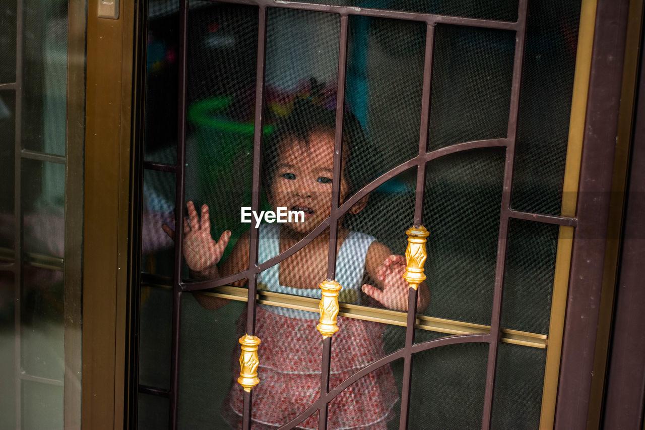 Baby Girl Looking Through Window