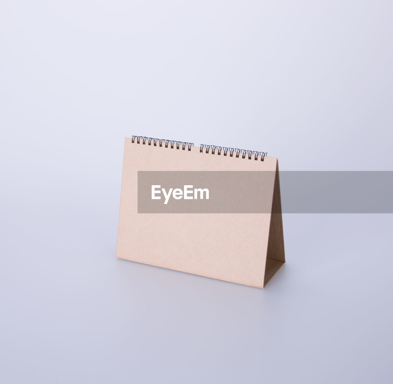studio shot, copy space, white background, indoors, cut out, paper, still life, no people, single object, close-up, blank, reminder, blue, note pad, communication, cardboard, spiral notebook, note, adhesive note, high angle view, message, blue background