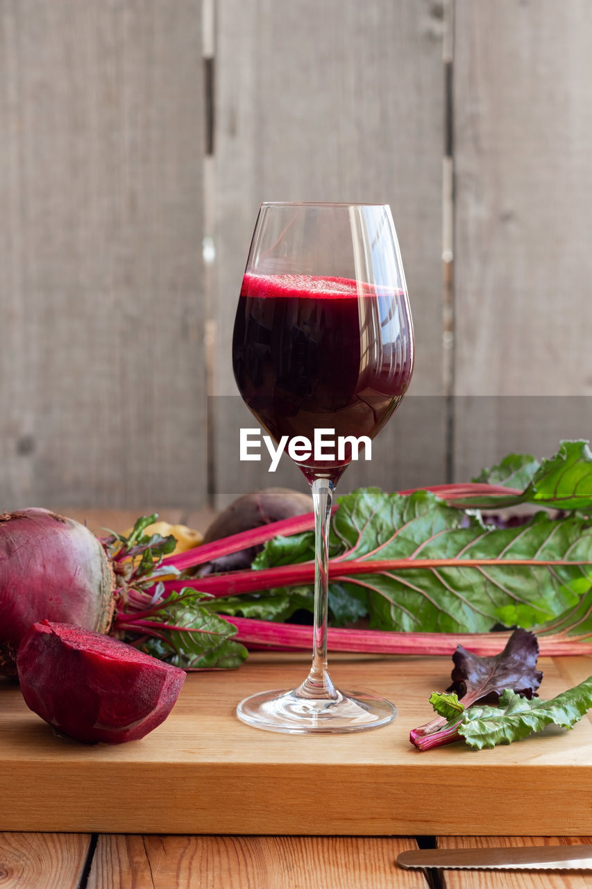 food and drink, wine, wineglass, table, glass, alcohol, red wine, food, freshness, drink, refreshment, vegetable, indoors, still life, red, no people, healthy eating, cutting board, wood - material, close-up, common beet