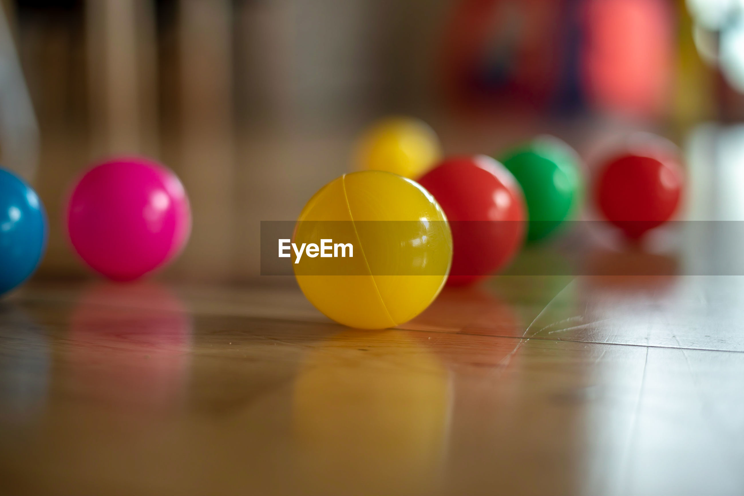 Close-up of multi colored balls on floor at home