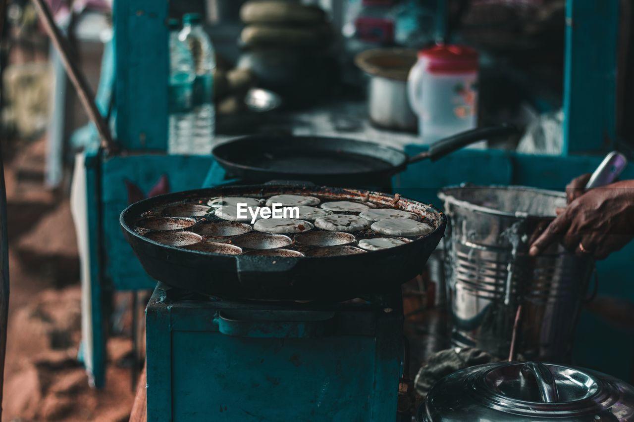 Cropped Image Of Hand Preparing Food At Market