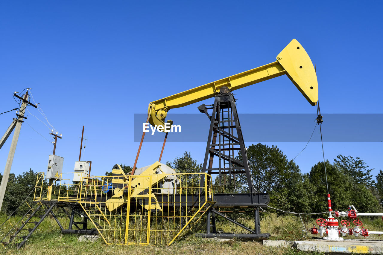 Oil Drill Against Clear Sky