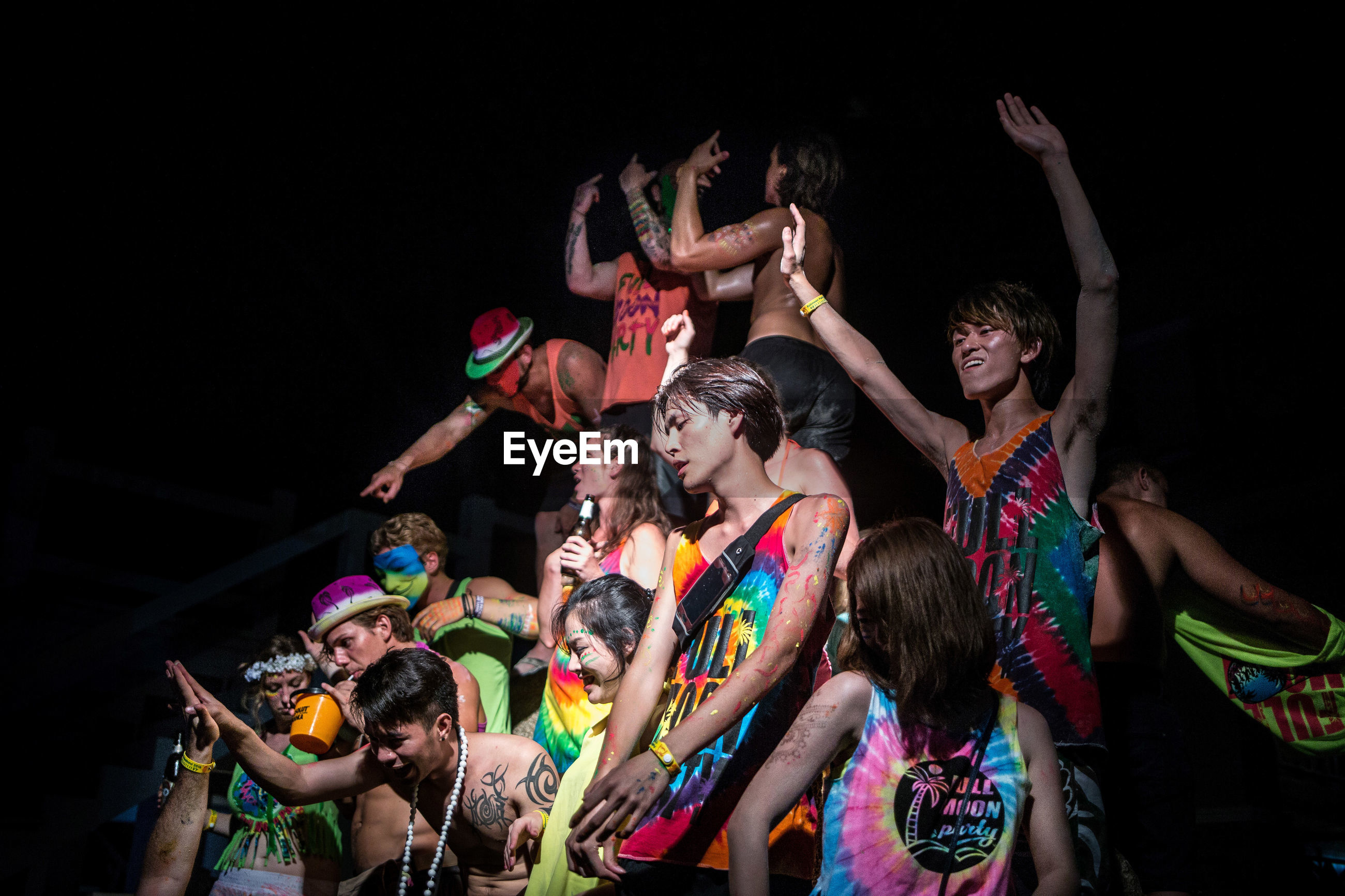 night, fun, young adult, dancing, multi colored, young women, celebration, happiness, party - social event, adults only, people, friendship, nightlife, adult, large group of people, clown, togetherness, outdoors
