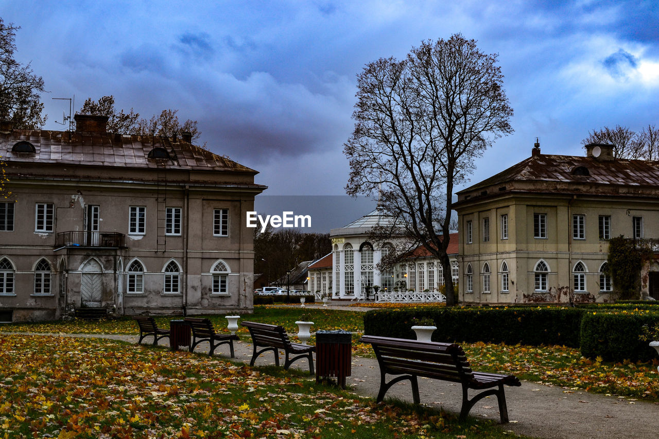 architecture, building exterior, built structure, building, sky, cloud - sky, tree, plant, seat, bench, nature, no people, residential district, house, city, day, outdoors, empty, autumn, leaf, change
