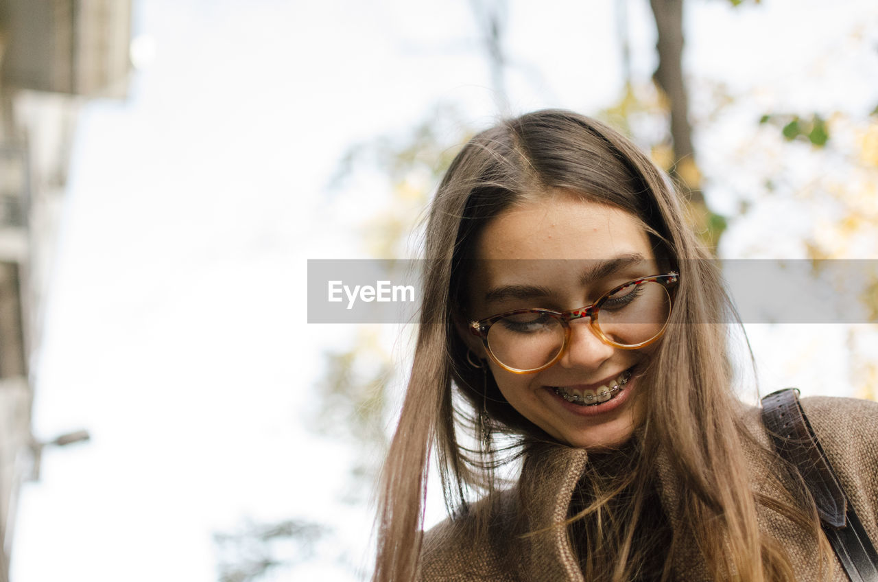 Close-up of smiling woman outdoors