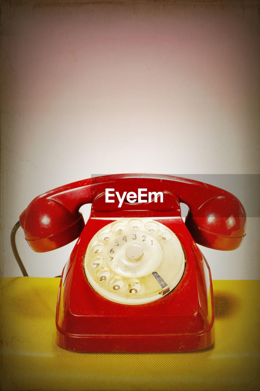 Retro red telephone over white background