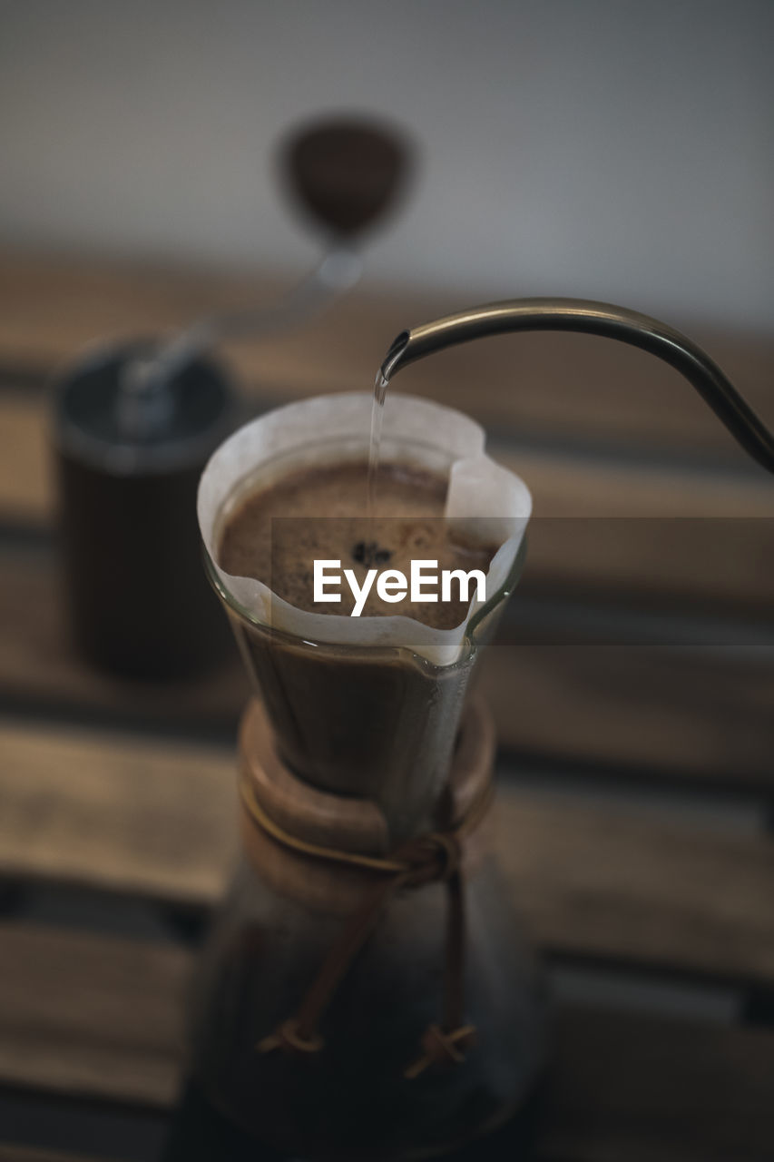 drink, refreshment, coffee, food and drink, coffee - drink, indoors, table, still life, coffee cup, mug, close-up, cup, no people, freshness, focus on foreground, selective focus, food, kitchen utensil, coffee maker, glass, latte